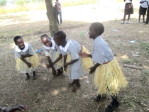 Four of our littlest ones dancing a traditional Acholi dance.